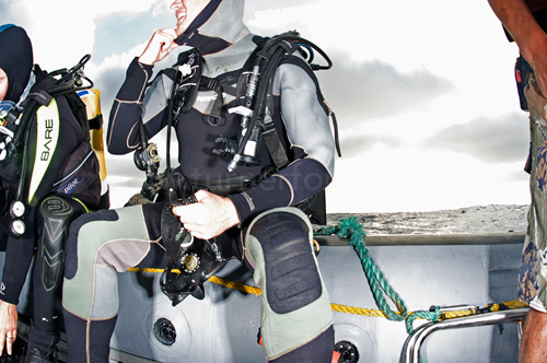 Scuba Divers geared up and ready to go underwater at the Revillagigedo Islands